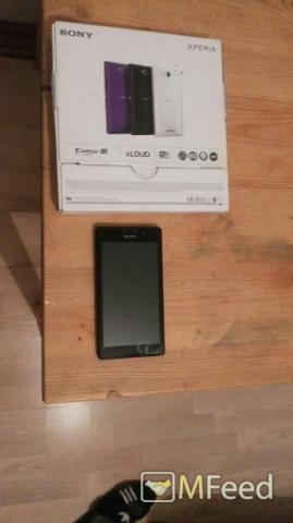Телефон Sony Xperia C